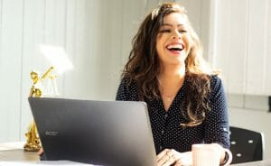 happy woman in front of laptop